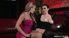 Hot kissing and boob grabbing action with lesbians Capri Cavanni and Taylor Vixen