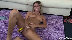 Alysha Rylee pushes the yellow tool right into her shaved beaver