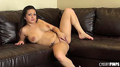 Every inch of the sex toy invades her cunt and the busty babe sighs with delight