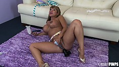 Busty Ava Devine is on the floor toying her pussy and her butt
