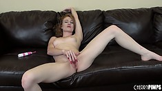 Pale redheaded beauty rubs her pretty pink cunt with her fingers