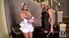 Sexy little blonde maid gets a paddling from her lesbian mistress