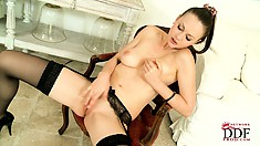 Bald pussy skinny brunette poses and shows off before rubbing cunt