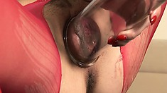 Elegant hussy in red panties Silvie is playing with suction device