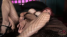Stacked redhead milf in hot fishnet bodysuit drills her tight cunt with a dildo