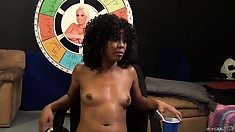 The ebony girl puts on display her lovely tits, sexy slim legs and her heavenly ass