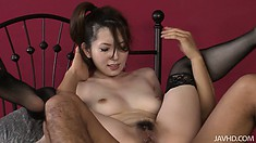 In her sexy black stockings, the hot babe rides that shaft eager to reach her climax