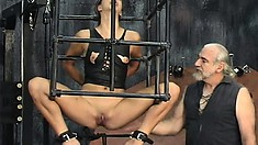 Naughty brunette babe makes her first debut in a torture chamber