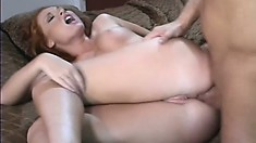 Fascinating young redhead with amazing big tits loves to get her ass drilled deep