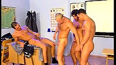Handsome jocks get down with their teacher for some extra credit