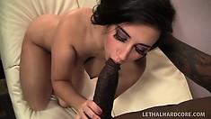 Curvy Valerie Kay puts her lusty lips around a vicious black boner