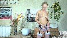 Dolly is a naughty cock-tease who loves taking all her clothes off