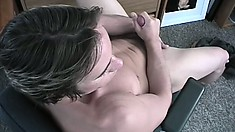 Hot stud with an amazing body jerks his long dick until it bursts with pleasure