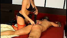 Huge titted dominant mistress drips hot wax on her submissive slave