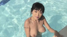 Enchanting Asian girl Jenny shows off her marvelous body in the pool