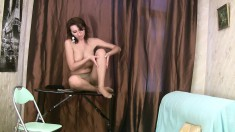 Hot Fira pulls her pantyhose down and pleases herself with her fingers
