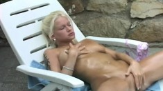 Pretty young blonde with awesome tits makes herself cum hard outside