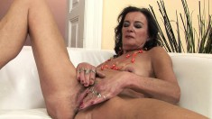 Naughty mature lady takes a dildo and a fist deep in her aching cunt