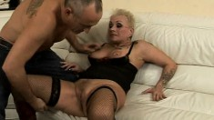 Short haired blonde mature in lingerie Nyikita has fun with sex toys