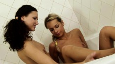 Cute brunette joins a sweet blonde for a lesbian affair in the bathtub