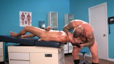 Tanned stallion lets this ripped gay man stuff his mouth with his cock