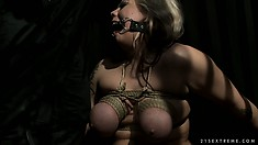 She blows, gets fingered and has her big tits tied up as he tortures her