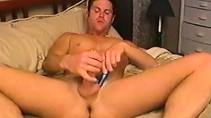 Horny stud Scott spreads his great body across the bed and pleases himself