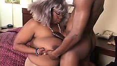 Giant black granny gags on his big black boner and rides it hard