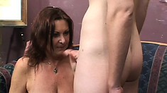Lustful mature lady blows the young stud's dick and has him pounding her wet cunt