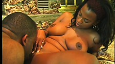 Two enticing caramel lesbians please each other and share a big black shaft