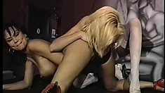 Experienced lesbian babes in lingerie bang in an old school video