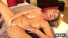 Sexy mature cock-tease rubs and fingers her creamy smooth beaver