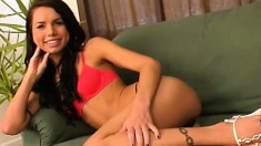 Slim brunette teen Micah Moore lies on the couch and pleases her pussy