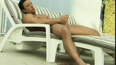 Hunk with a big cock goes solo in the jaccuzzi for the camera