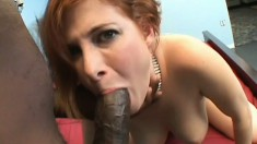 Busty redhead with a superb ass makes the most of her time with a huge black cock