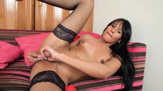 Tempting brunette shemale fucks herself with a dildo and masturbates