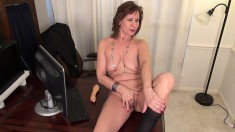 Lustful mature secretary Penny takes her pussy to orgasm in the office