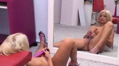 Sexy blonde Zdenka masturbates in front of a mirror to watch her twat