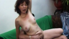 Naughty mature with big boobs knows her way around a young stud's cock