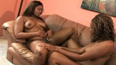 Dark skinned hotties pleasing each other's sweet peaches with sex toys