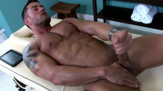Gorgeous guy peels off his clothes and sensually strokes his big dick