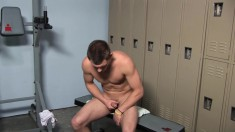 Handsome boy gets horny in the locker room and decides to learn new ways to satisfy himself