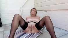 Busty blonde in stockings plays with her sex toys