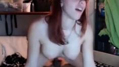 Naughty redhead rides hard on livecam